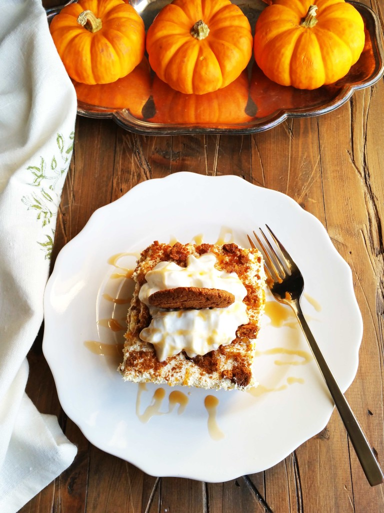 This Salted Caramel Pumpkin Poke Cake is super easy to make and soooo delicious! All it takes is a yellow cake mix, salted caramel sundae sauce, sweetened condensed milk, pumpkin and spice. The icing is a simple mixture of cool whip and vanilla pudding with ginger snaps.