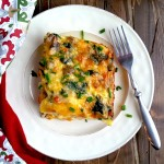 This breakfast casserole is perfect for holiday brunch! It is loaded with a crescent roll crust, sausage, bacon, mushrooms, spinach and colby jack cheese.