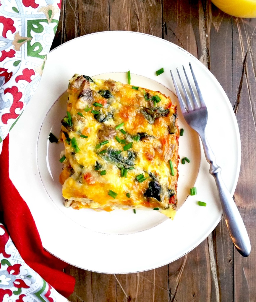 This Best Breakfast Egg Casserole is LOADED with all the best stuff...spinach, mushrooms, sausage, bacon, onions, red peppers, Colby jack cheese and a crescent crust!