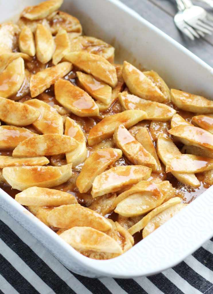 This overnight, Baked Apple French Toast Casserole has a warm, brown sugar, butter and cinnamon sauce.  It is my family's favorite breakfast recipe of all time.  A generous heaping of Granny Smith apples gets coated with a light dusting of cinnamon and sugar before baking it in the oven.