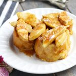 This Overnight Apple French Toast Casserole has a warm, brown sugar, butter and cinnamon sauce.  It is my family's favorite breakfast recipe of all time.  A generous heaping of Granny Smith apples gets coated with a light dusting of cinnamon and sugar before baking it in the oven.