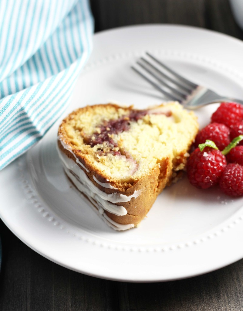 This Raspberry Cream Cheese Coffee Cake is the perfect touch of sweetness to your breakfast! It is drizzled with a confectioners sugar glazewith a surprising cream cheese and raspberry jam filling.