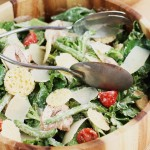 A delicious and CREAMY lightened up Kale Caesar Salad with french green beans, cherry tomatoes and asiago crisps!