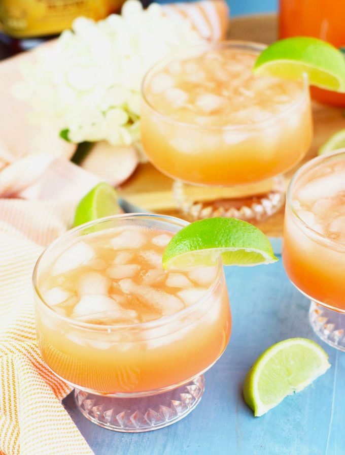 his Jamaican Rum Punch is the perfect party drink that gets prepared in a pitcher and poured over ice. It is super refreshing with orange juice, pineapple juice, lime juice and cherry grenadine.