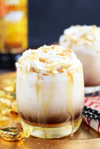 This Caramel Creme Brulee White Russian is inspired by one of my favorite seasonal latte flavors at Starbucks. The addition of vanilla and caramel syrup, a floating of whipped cream, and crushed caramel candies makes this themost decadent drink combination.