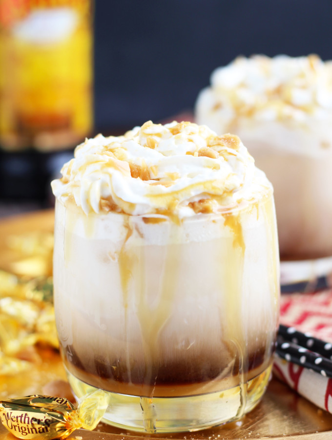 This Caramel Creme Brulee White Russian is inspired by one of my favorite seasonal latte flavors at Starbucks.  The addition of vanilla and caramel syrup, a floating of whipped cream, and  crushed caramel candies makes this the most decadent drink combination.