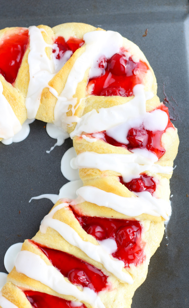 Add a festive Candy Cane Crescent Roll Breakfast Pastry with a cream cheese and cherry filling to your Christmas brunch.  It is sure to impress with minimal effort for a breezy Christmas treat.