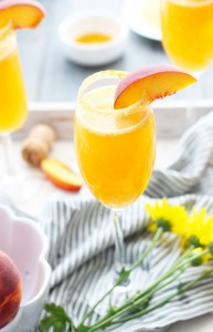 Peach Pie Bellinis with peach schnapps, peach puree, moscato champagne and a graham cracker rim.