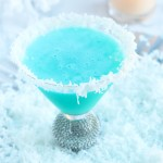 This Snowflake Martini is a winter wonderland with the flavors of Blue Curacao, pineapple and coconut.