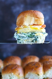 A generous layer of my favorite Spinach Artichoke Dip makes an appearance in these breakfast sliders with egg, ham and cheese.