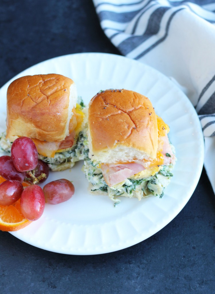 These Spinach Artichoke Dip Breakfast Sliders have a generous layer of my favorite dip with egg, ham and cheese on a Hawaiian roll.
