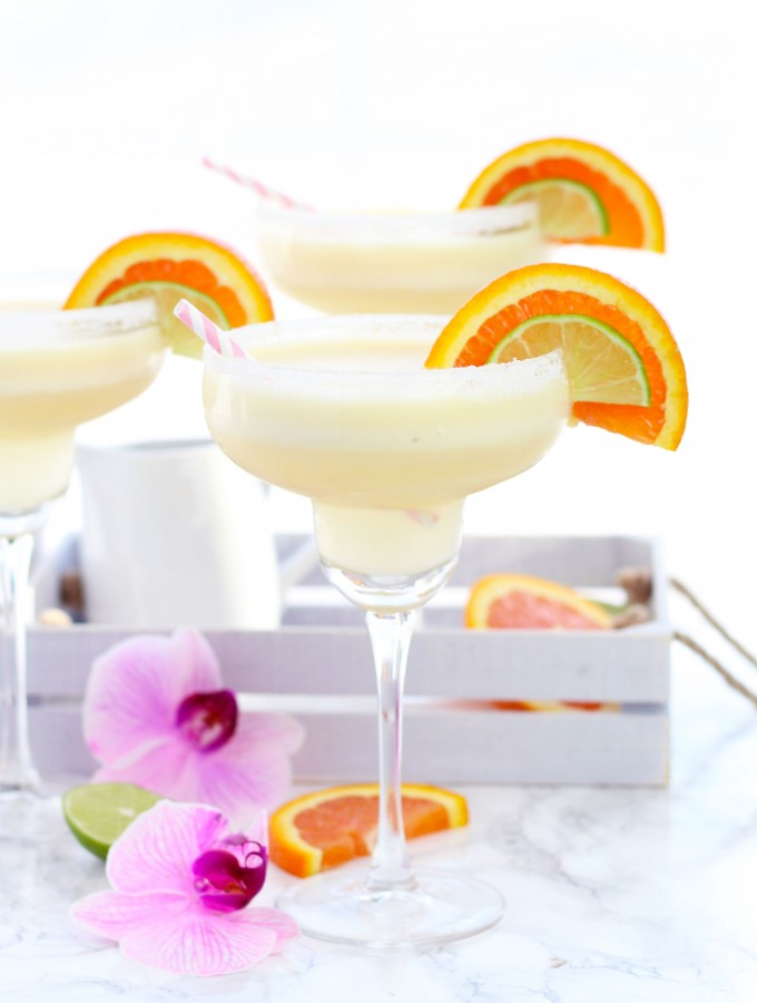 A frozen, Orange Creamsicle Margarita is a refreshing blend of cream, orange and lime juices.