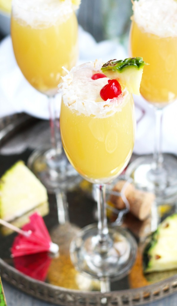 These Tropical Mimosas are great for brunch with pineapple juice and coconut flavors.