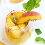 I've combined 2 of my favorite cocktails with this Fuzzy Navel Peach Sangria with White Moscato and fresh peaches.