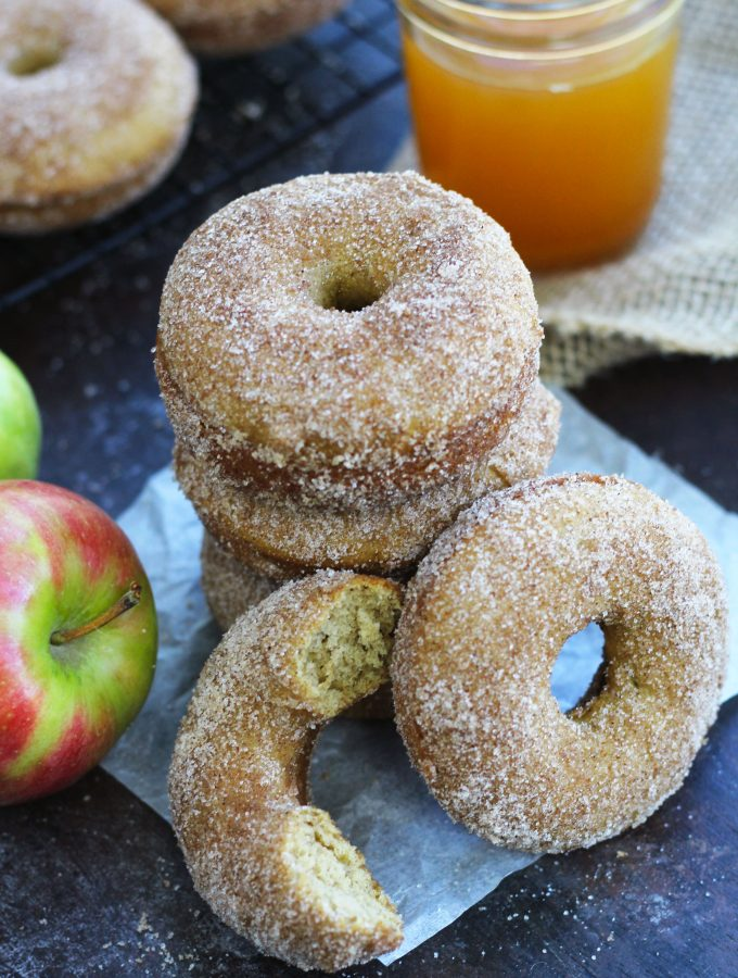 These Baked Apple Cider Doughnuts are bursting with apple flavor and are topped with cinnamon sugar.
