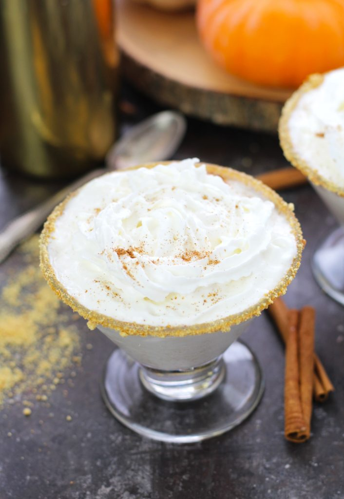 Drink your fall dessert with this decadent pumpkin pie martini with a graham cracker rim and whipped cream topping.