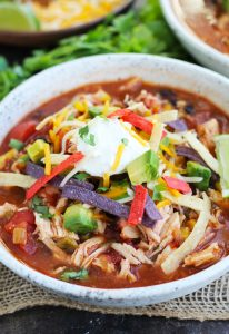 This hearty, Slow Cooker Chicken Tortilla Soup is perfect for busy nights and is loaded with all the best toppings.