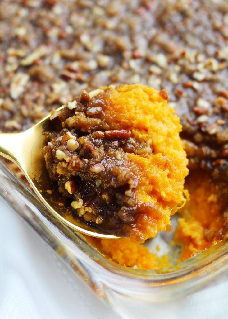 This Sweet Potato Casserole with Pecan Topping is easily put together the night before for a no fuss Thanksgiving day side dish. The delectable brown sugar and pecan topping adds the perfect balance of creamy and crispy textures.