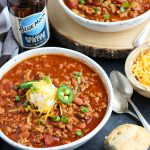 This Slow Cooker Beer Chili is easily made with ground beef or turkey.  A bottle of your favorite beer gets added with pinto beans, onion, tomato, jalapeno pepper and spices.  This recipe is perfect for game day entertaining.