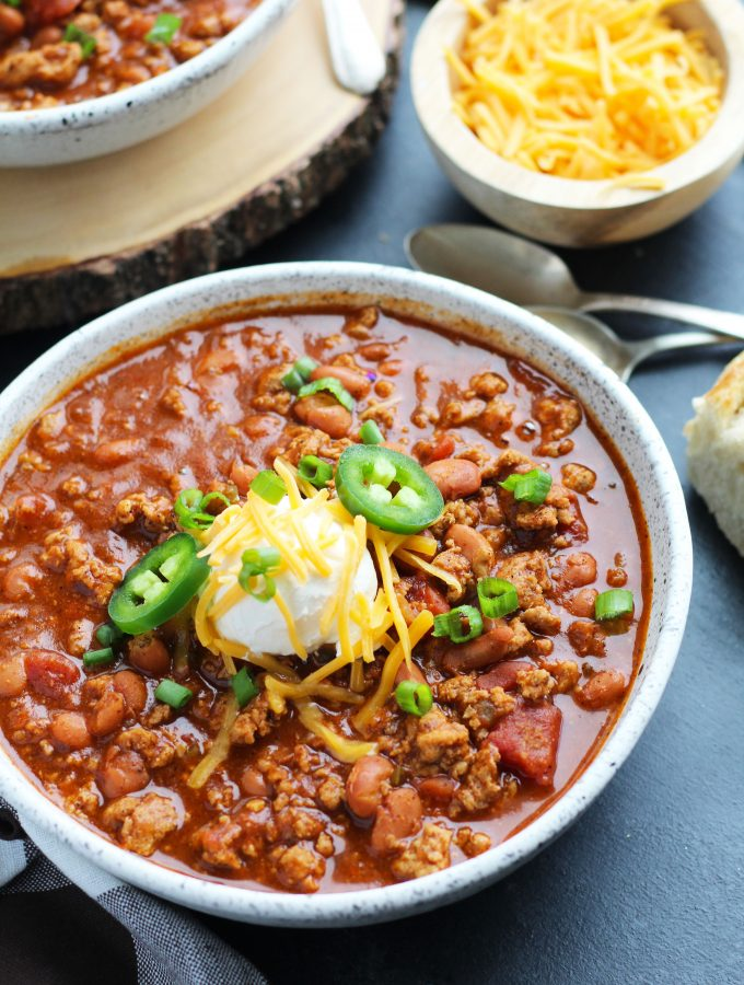 This Slow Cooker Beer Chili is easily made with ground beef or turkey.  A bottle of your favorite beer gets added with pinto beans, onion, tomato, jalepeno pepper and spices.  This recipe is perfect for game day entertaining.