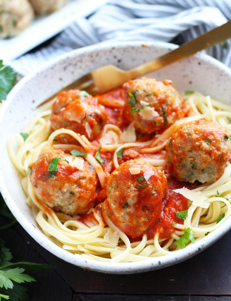 These Baked Turkey Meatballs are a great, healthier alternative with minimal prep time. Plenty of Parmesan cheese, Panko breadcrumbs and seasoning make these a flavorful meal that can be served with zoodles or noodles. Freeze any leftovers for a quick weeknight meal!
