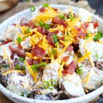 This Loaded Potato Salad is a great, easy side dish for your summer barbecues. A sour cream and ranch mixture add plenty of flavor with a bacon, cheddar cheese and green onion topping.