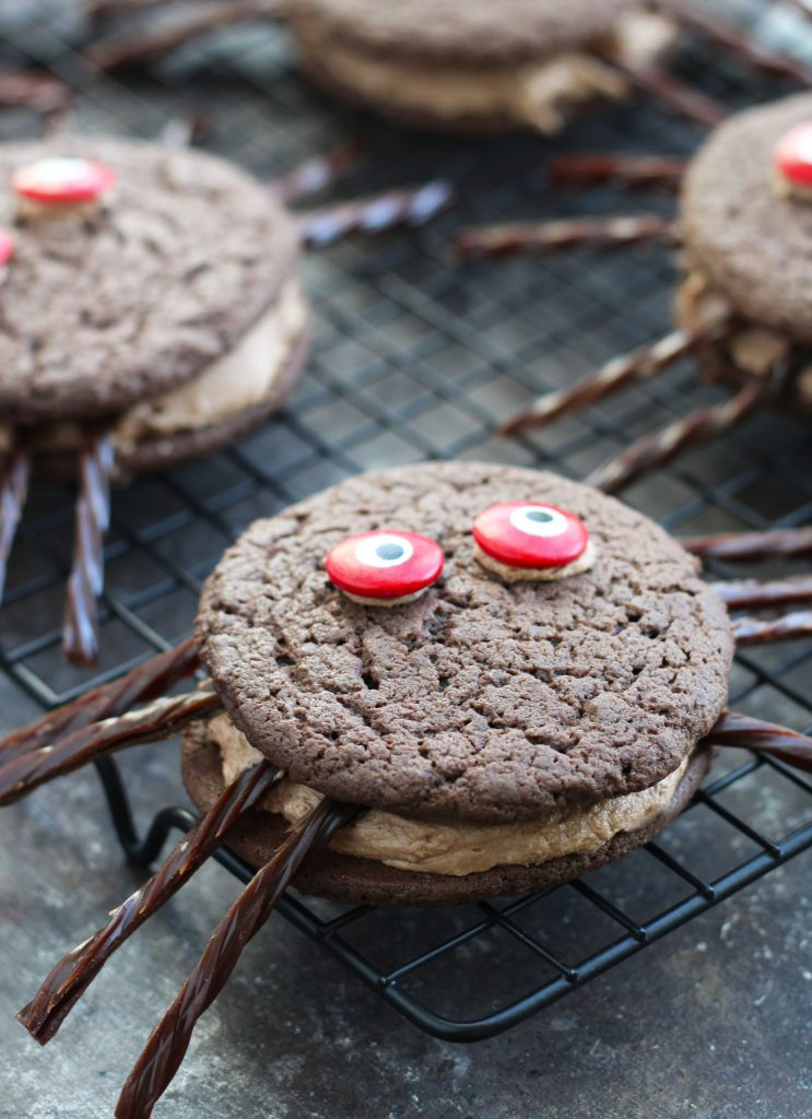 These Chocolate Spider Whoopie Pies are so fun and easy to make with the kids. The cookies are made with cake mix with a chocolate marshmallow creme filling.