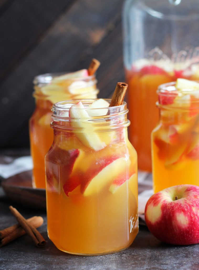 This Fireball Apple Cider Sangria is the perfect fall party cocktail. Fresh apples and cinnamon sticks add to this flavorful cocktail with apple cider, Pinot Grigio, Fireball Cinnamon Whisky and a splash of ginger ale.