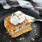 This No Bake Pumpkin Cheesecake Lasagna makes a quick and easy holiday dessert.  It has layers of cinnamon graham crackers, caramel sauce, pumpkin cheesecake, pudding and toffee bits for plenty of flavor.  Freeze it the night before for a no-fuss holiday dessert.