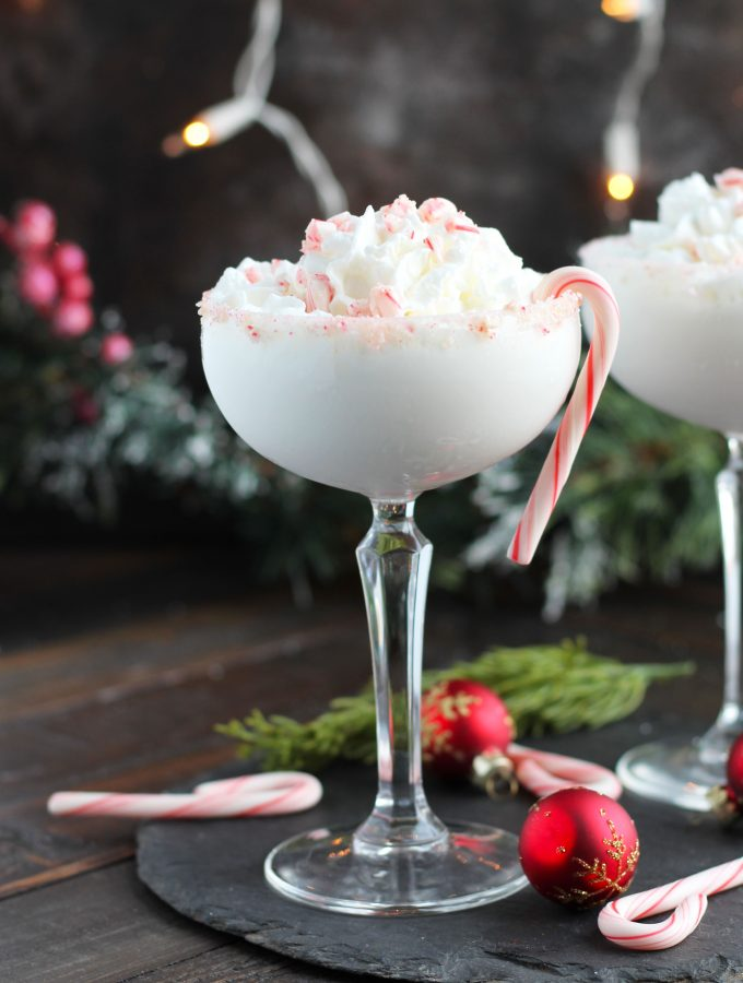 This Candy Cane Martini is so festive for the holidays with vanilla vodka and peppermint schnapps.  Add a floating of whipped cream with crushed candy for a beautiful presentation.