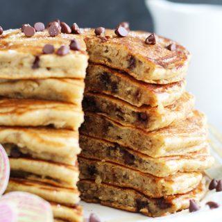 Chocolate Chip Banana Pancakes are the perfect way to use up those ripe bananas.  These fluffy pancakes have a bit of applesauce for added moisture with plenty of fresh banana and chocolate chips for added sweetness.