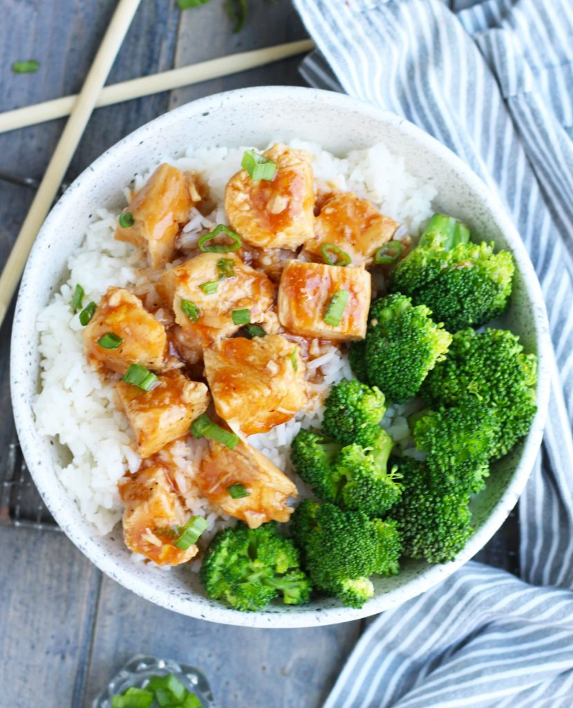 This Crockpot Orange Chicken is super easy to make with barbecue sauce, orange marmalade, soy sauce and orange juice.  It is part of my weekly dinner rotation and popular with the kids.  Serve it in a bowl over rice or stir-fried noodles with veggies for a complete meal.