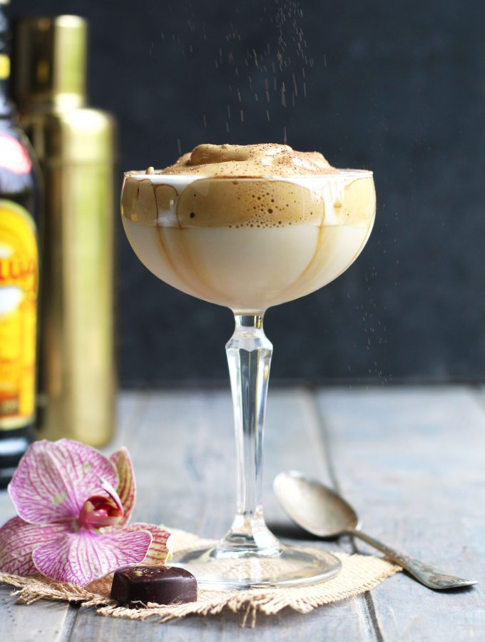 This Whipped Coffee Martini has a creamy topping made by mixing instant coffee, sugar and water.  The addition of vanilla vodka and Kahlua with a dusting of cocoa powder make it a delectable treat.