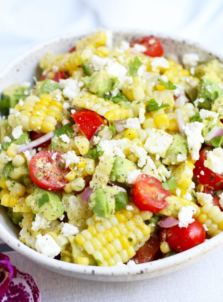 This Corn Salad with Avocado is so flavorful with cherry tomatoes, feta cheese and a honey lime dressing.  Serve it fresh for summer BBQ's for an easy side dish that will be a new family favorite.