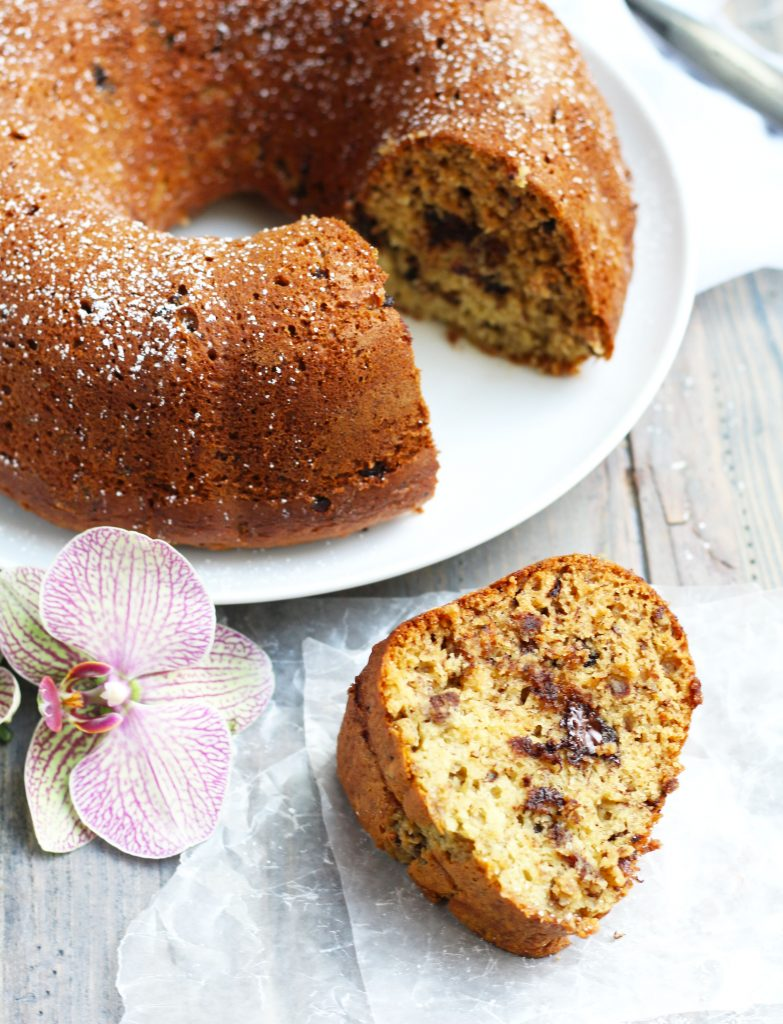 This Vanilla Pudding Banana Bread is so moist and flavorful with chocolate chunks and pecan pieces.  Make it in a bundt or loaf pan and personalize it with your favorite nuts and chocolate.