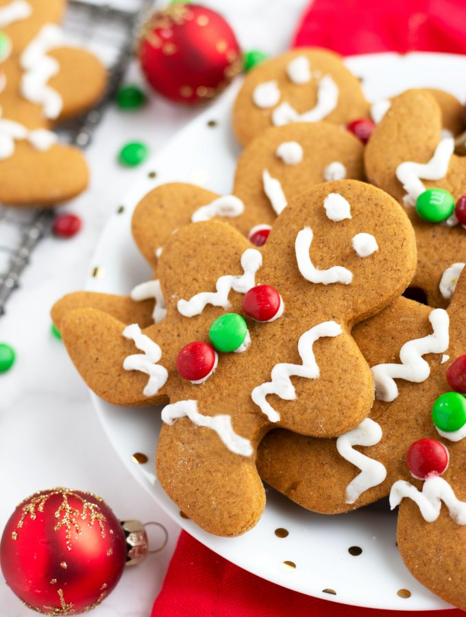 These Soft Gingerbread Cookies with Icing are so festive and easy for the holidays. Add decorator icing and candies to make a gingerbread man or enjoy them plain for a quick addition to your cookie platter.