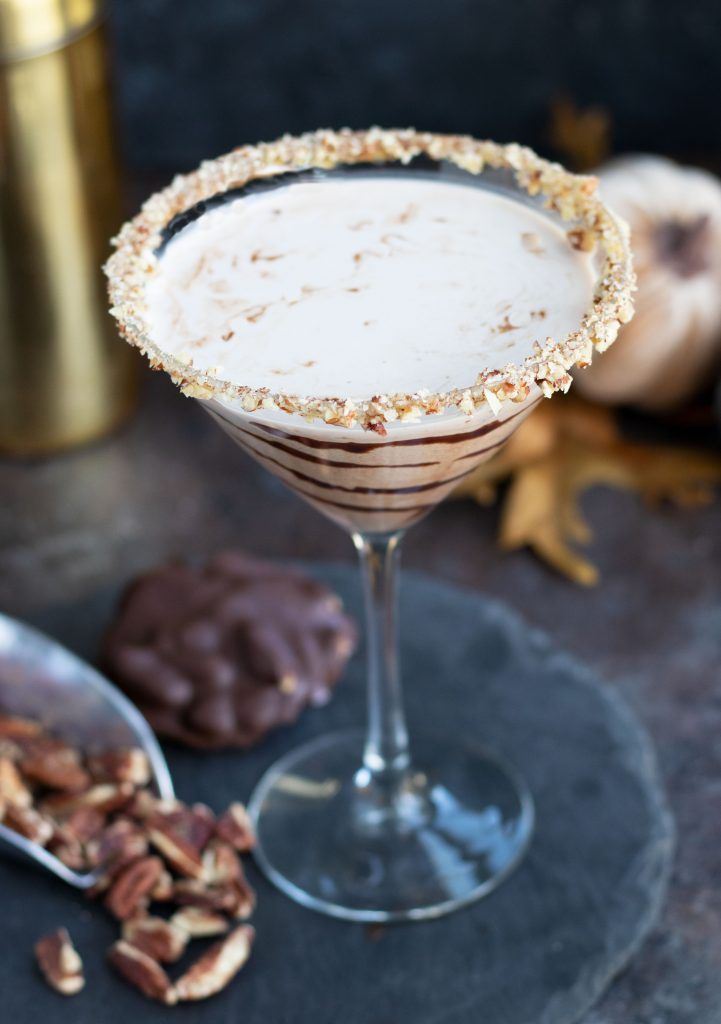 This Chocolate Turtle Martini with Pecan Whiskey, Crème de Cacao and Butterscotch Schnapps is a decadent cocktail that is perfect for entertaining. It gets topped off with a caramel and rim with chopped pecans and a swirl of chocolate sauce.