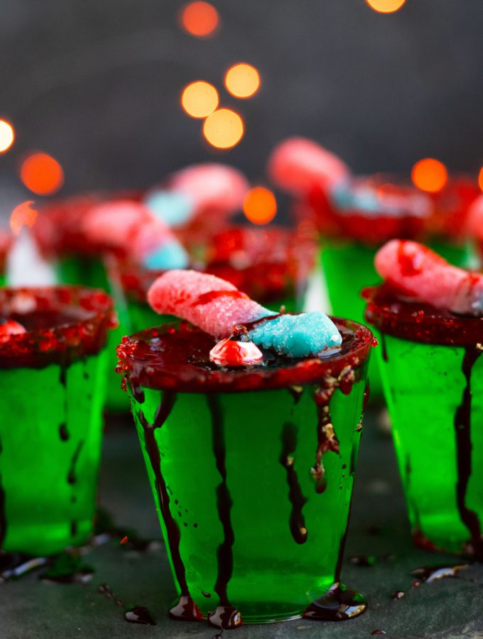 These Zombie Brain Margarita Jello shots with lime Jello, triple sec, lime juice and gold tequila are perfect for Halloween parties. Top these spooky treats off with fake blood, gummy worms and a sugared rim.